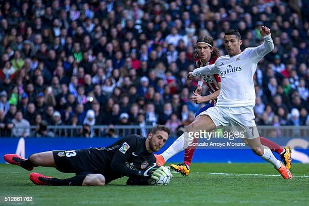Goalkeeper Jan Oblak of Atletico de Madrid stops the ball striked by Cristiano Ronaldo of Real Madrid CF during the La Liga match between Real Madrid...
