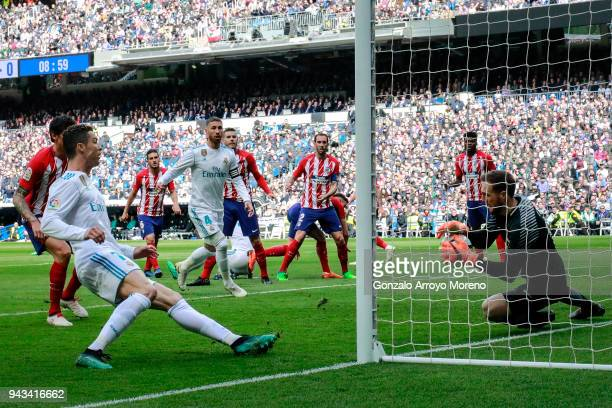 Goalkeeper Jan Oblak of Atletico de Madrid stops the shot of Cristiano Ronaldo of Real Madrid CF during the La Liga match between Real Madrid CF and...