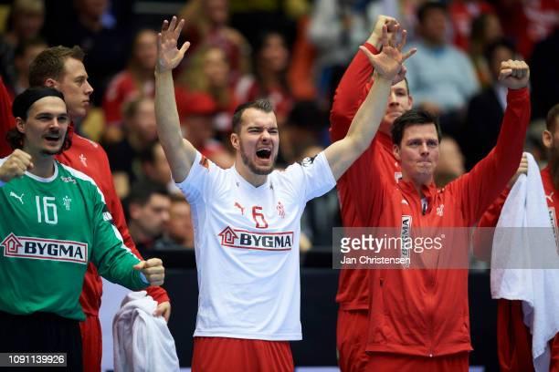 Goalkeeper Jannick Green of Denmark, Casper U. Mortensen of Denmark and Hans Lindberg of Denmark celebrate after goal during the IHF Men's World...