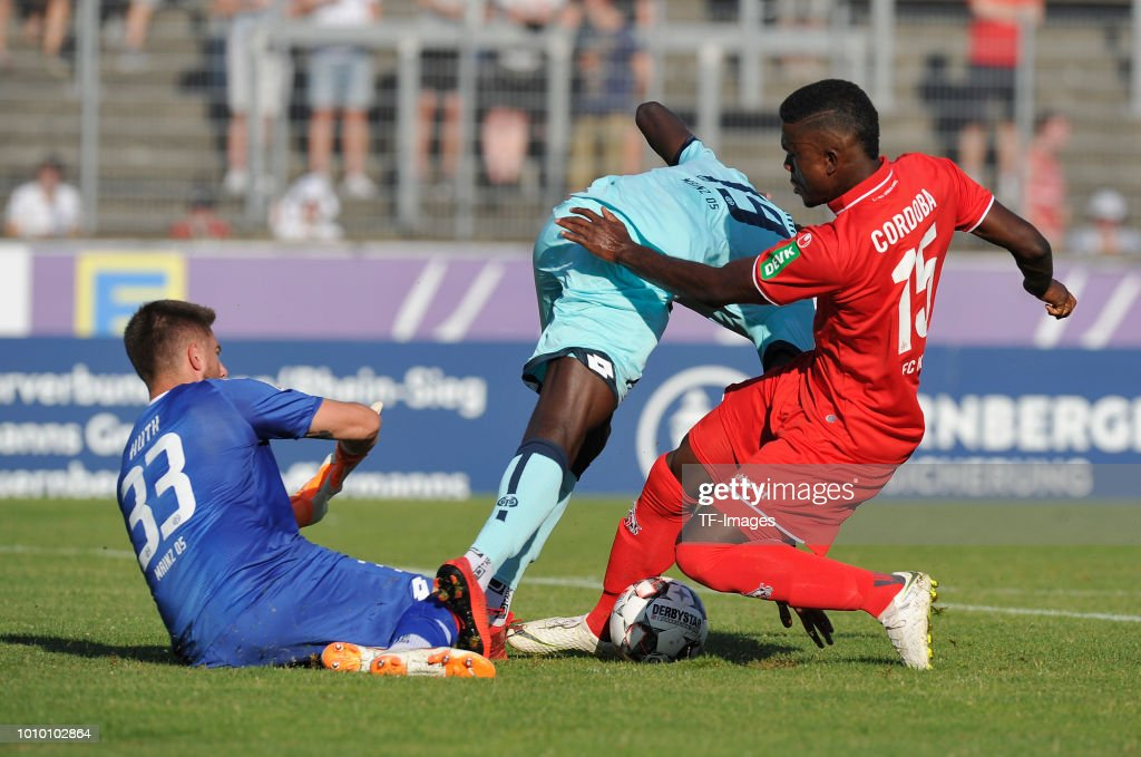 Goalkeeper Jannik Huth of Mainz , Moussa Niakhate of Mainz and Jhon Cordoba of Koeln battle for the ball during the pre-season friendly match between 1. FC Koeln and 1. FSV Mainz 05 at Sportpark Nord on July 27, 2018 in Bonn, Germany.