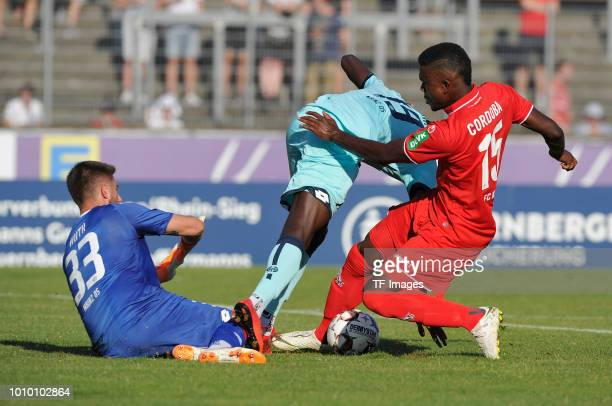 Goalkeeper Jannik Huth of Mainz Moussa Niakhate of Mainz and Jhon Cordoba of Koeln battle for the ball during the preseason friendly match between 1...