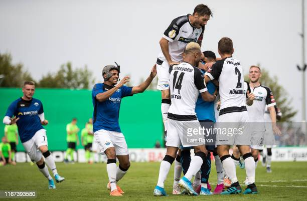 Goalkeeper Jannik Huth of Paderborn celebrates with Cauly Oliveira Souza of Paderborn after winning the DFB Cup first round match between SV...