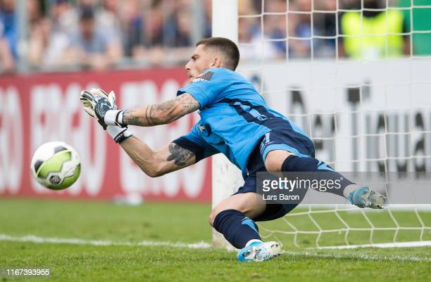Goalkeeper Jannik Huth of Paderborn saves a penalty of Lars Lokotsch of Roedinghausen during the DFB Cup first round match between SV Roedinghausen...
