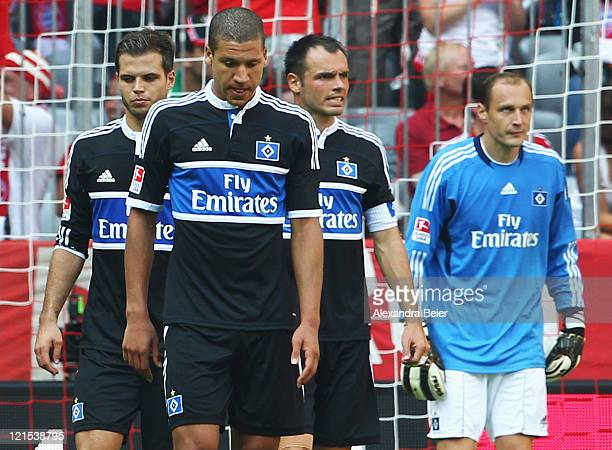 Goalkeeper Jaroslav Drobny Heiko Westermann Jeffrey Bruma and Dennis Diekmeier of Hamburg react after they missed to avoid a fourth goal during the...