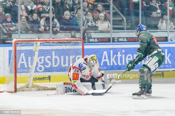 goalkeeper Jaroslav Huebl of Fischtown Pinguins Bremerhaven and Adam Payerl of AEV Augsburger Panther battle for the ball during the DEL match...
