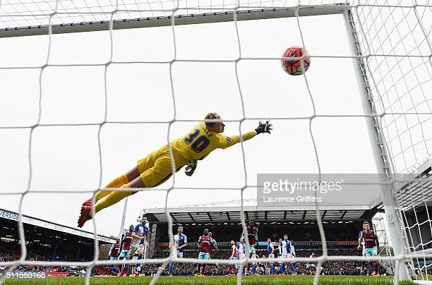 Goalkeeper Jason Steele of Blackburn Rovers dives in vain as Dimitri Payet of West Ham United scores his team's second goal from a free kick during...
