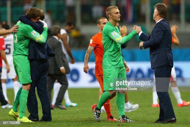 Goalkeeper Jasper Cillessen of the Netherlands celebrates with head coach Louis van Gaal as substitute goalkeeper Tim Krul receives the plaudits...