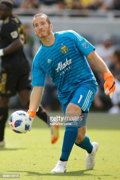 Goalkeeper Jeff Attinella of the Portland Timbers rolls the ball to a teammate during action against Los Angeles FC at Banc of California Stadium on...
