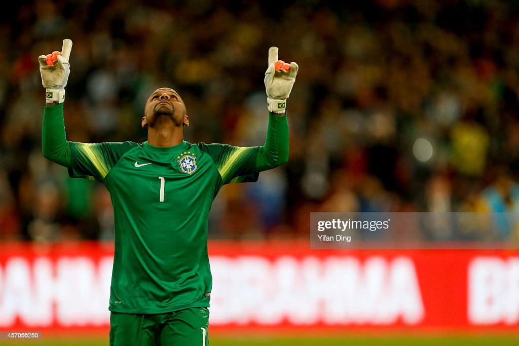 Goalkeeper Jefferson #1 of Brazil celebrates after saving Lionel Messi's penalty kick during a match between Argentina and Brazil as part of 2014 Superclasico de las Americas at Bird Nest Stadium on October 11, 2014 in Beijing, China.
