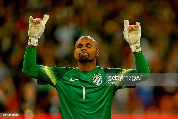 Goalkeeper Jefferson of Brazil celebrates after saving the penalty of Lionel Messi during a match between Argentina and Brazil as part of 2014 Super...