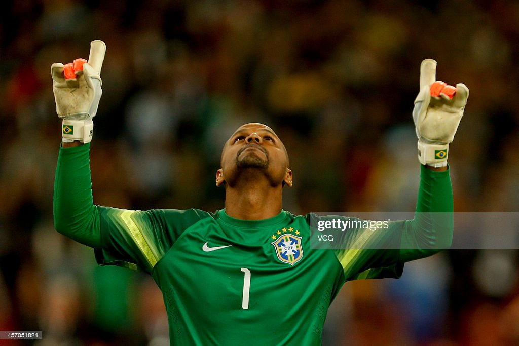 Goalkeeper Jefferson #1 of Brazil celebrates after saving the penalty of Lionel Messi during a match between Argentina and Brazil as part of 2014 Super Clasico at Beijing National Stadium on October 11, 2014 in Beijing, China.