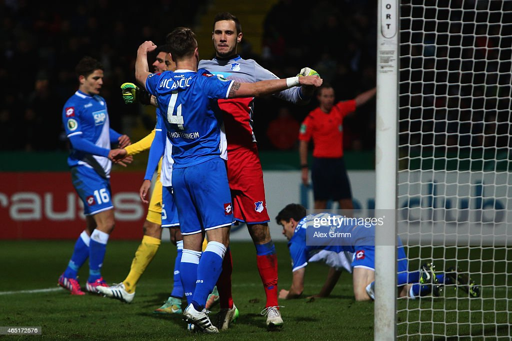 Goalkeeper Jens Grahl of Hoffenheim celebrates with team mate Ermin Bicakcic after a save during the DFB Cup Round of 16 match between VfR Aalen and 1899 Hoffenheim at Scholz Arena on March 3, 2015 in Aalen, Germany.