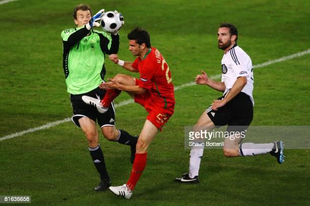 Goalkeeper Jens Lehmann of Germany collides with Helder Postiga of Portugal as Christoph Metzelder looks on during the UEFA EURO 2008 Quarter Final...
