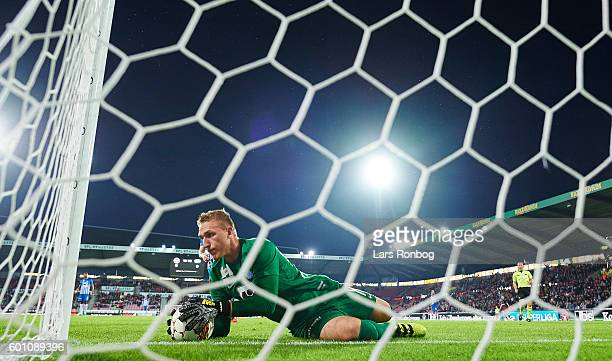 Goalkeeper Jeppe Hojbjerg of Esbjerg fB saves the ball during the Danish Alka Superliga match between FC Midtjylland and Esbjerg fB at MCH Arena on...