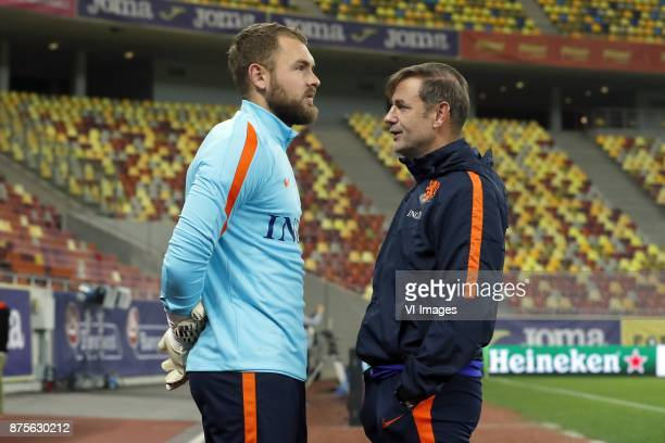 goalkeeper Jeroen Zoet of Holland goalkeeper trainer Frans Hoek of Holland during a training session prior to the friendly match between Romania and...