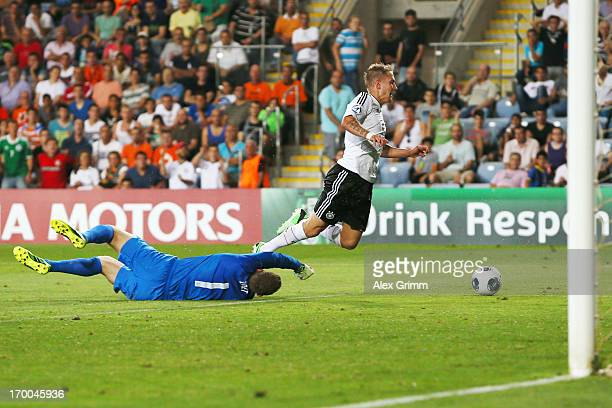 Goalkeeper Jeroen Zoet of Netherlands fouls Lewis Holtby of Germany for a penalty during the UEFA European Under 21 Championship match between...