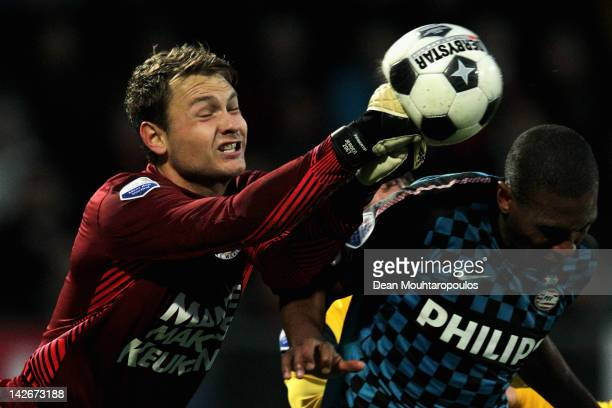 Goalkeeper, Jeroen Zoet of RKC punches the ball away from Orlando Engelaar of PSV during the Eredivisie match between RKC Waalwijk and PSV Eindhoven...