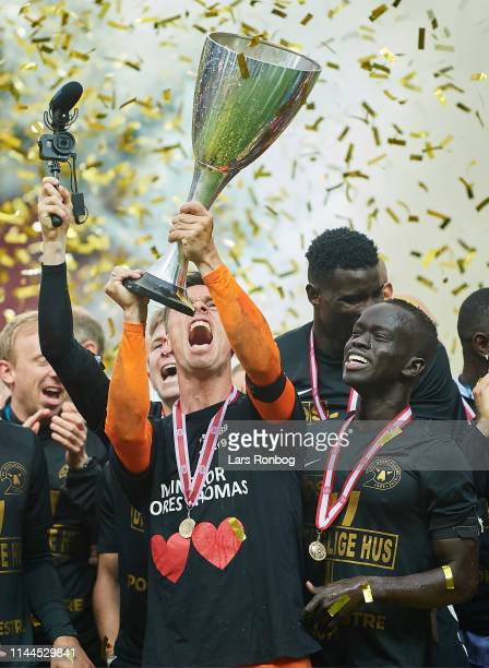 Goalkeeper Jesper Hansen and Awer Mabil of FC Midtjylland lifting the trophy as cup winners after the Danish Cup Final Sydbank Pokalen match between...
