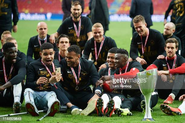 Goalkeeper Jesper Hansen and Awer Mabil of FC Midtjylland with the trophy as cup winners after the Danish Cup Final Sydbank Pokalen match between...