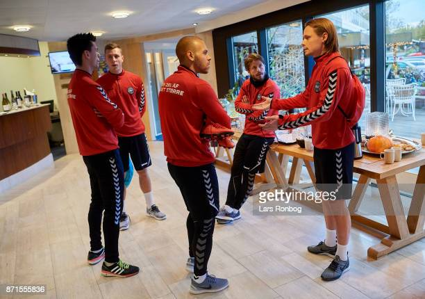 Goalkeeper Jesper Hansen Lukas Lerager Martin C Braithwaite Lasse Schone and Peter Ankersen talking prior to the Denmark training session at...