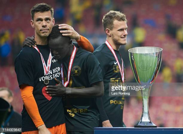 Goalkeeper Jesper Hansen of FC Midtjylland and Awer Mabil of FC Midtjylland showing emotions near the trophy after the Danish Cup Final Sydbank...