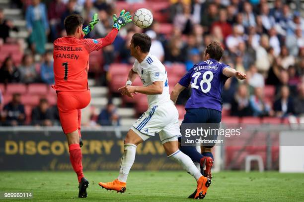 Goalkeeper Jesper Hansen of FC Midtjylland Pieros Sotiriou of FC Copenhagen and Erik Sviatchenko of FC Midtjylland compete for the ball during the...