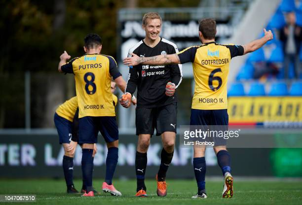 Goalkeeper Jesper Rask of Hobro IK and Nicholas Gotfredsen of Hobro IK celebrate after the Danish Superliga match between Hobro IK and FC...
