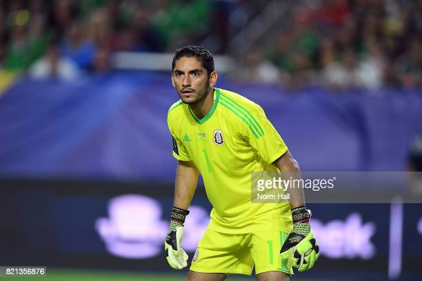 Goalkeeper Jesus Corona of Mexico gets ready to make a save against Honduras in a quarterfinal match during the CONCACAF Gold Cup at University of...