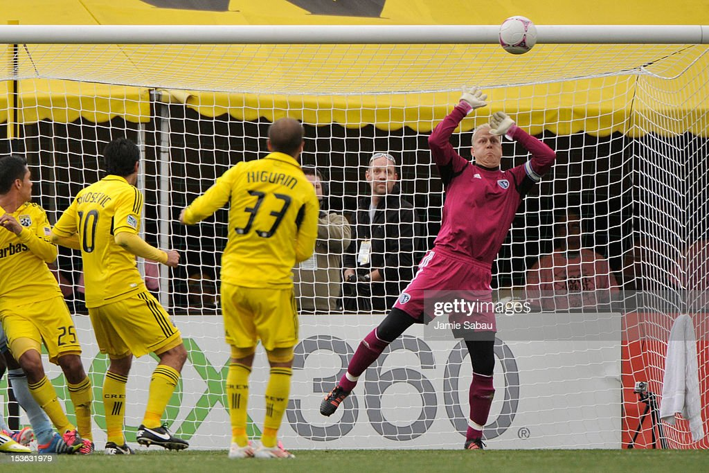 Goalkeeper Jimmy Nielsen #1 of Sporting Kansas City makes a save on a free kick from Federico Higuain #33 of the Columbus Crew on October 7, 2012 at Crew Stadium in Columbus, Ohio.