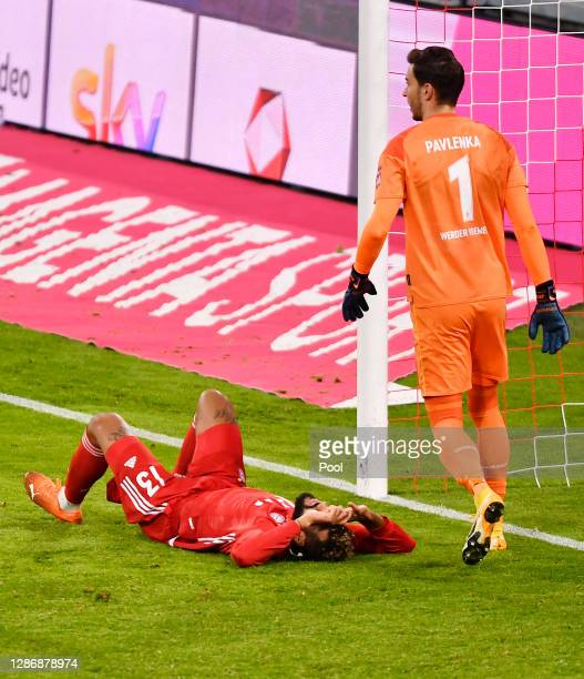 Goalkeeper Jiri Pavlenka of Bremen and Eric Maxim ChoupoMoting of Muenchen react during the Bundesliga match between FC Bayern Muenchen and SV Werder...