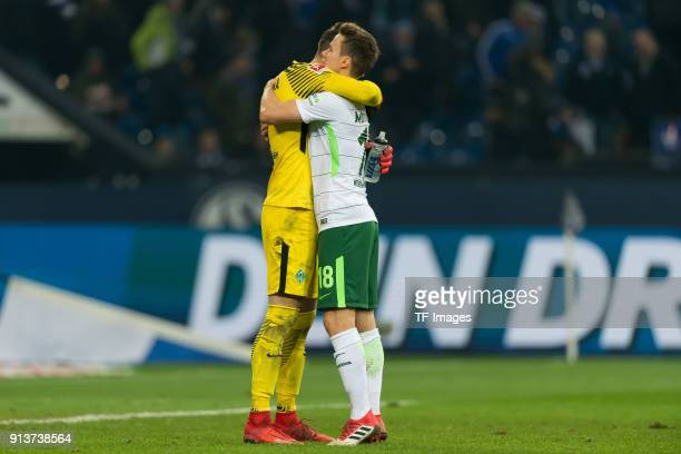 Goalkeeper Jiri Pavlenka of Bremen and Niklas Moisander of Bremen celebrate after winning the Bundesliga match between FC Schalke 04 and SV Werder...