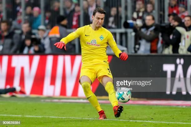 Goalkeeper Jiri Pavlenka of Bremen controls the ball during the Bundesliga match between FC Bayern Muenchen and SV Werder Bremen at Allianz Arena on...