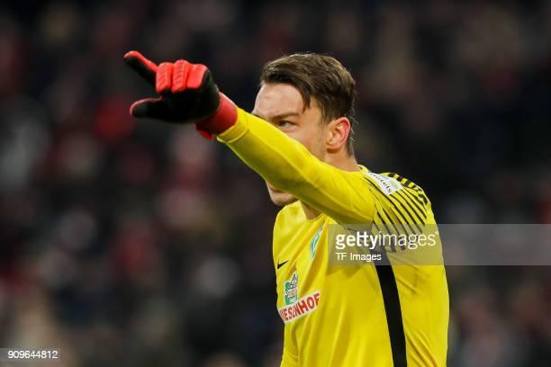 Goalkeeper Jiri Pavlenka of Bremen gestures during the Bundesliga match between FC Bayern Muenchen and SV Werder Bremen at Allianz Arena on January...