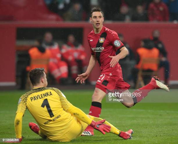 Goalkeeper Jiri Pavlenka of Bremen on the ground and Dominik Kohr of Leverkusen runs during the DFB Cup match between Bayer Leverkusen and Werder...