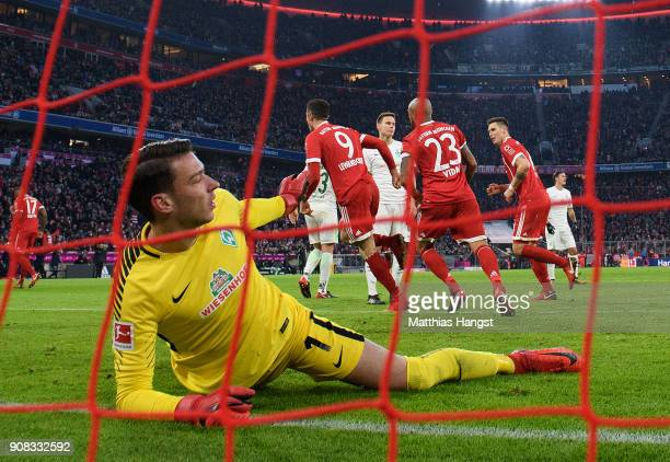 Goalkeeper Jiri Pavlenka of Bremen reacts after Robert Lewandowksi of FC Bayern Muenchen scored his team's second goal during the Bundesliga match...