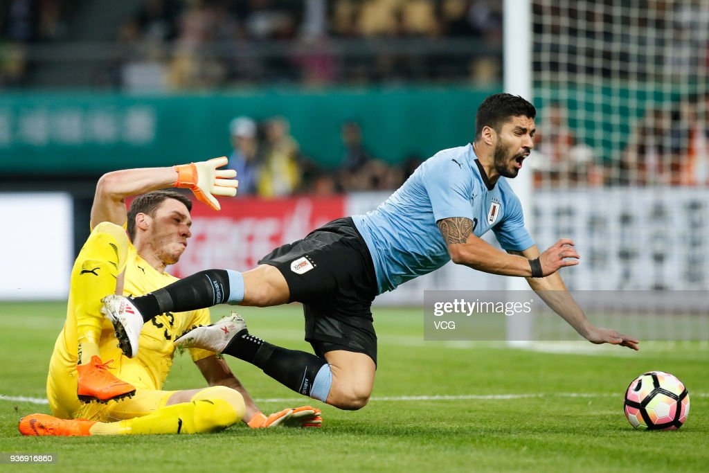 Goalkeeper Jiri Pavlenka #23 of Czech Republic fouls Luis Suarez #9 of Uruguay to give away a penalty during the 2018 China Cup International Football Championship match between Uruguay and Czech Republic at Guangxi Sports Center on March 23, 2018 in Nanning, China.
