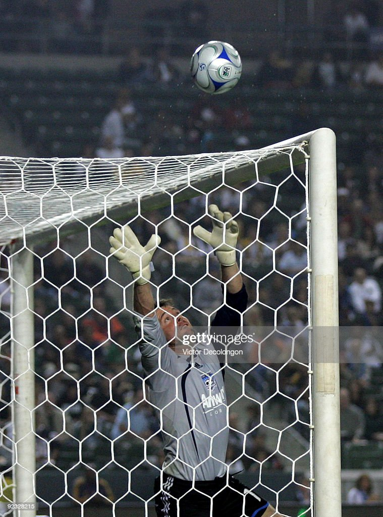 Goalkeeper Joe Cannon #1 of the San Jose Earthquakes looks to make a save in the first half during the MLS match against the Los Angeles Galaxy at The Home Depot Center on October 24, 2009 in Carson, California. The Galaxy defeated the Earthquakes 2-0.