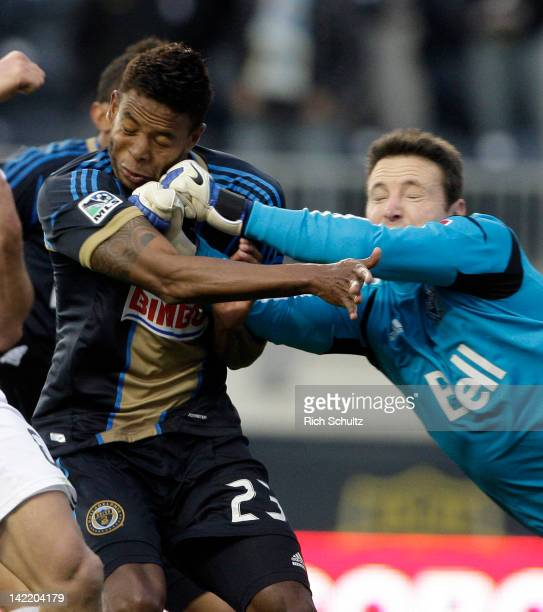 Goalkeeper Joe Cannon of the Vancouver Whitecaps accidentally punches Lionard Pajoy of the Philadelphia Union in the face while he attempts to make a...