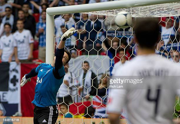 Goalkeeper Joe Cannon of the Vancouver Whitecaps and Alain Rochat watches the shot of Eddie Johnson of the Seattle Sounders hit the back of the net...