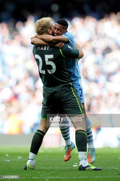 Goalkeeper Joe Hart and Gael Clichy of Manchester City celebrate winning the title as the final whistle blows during the Barclays Premier League...
