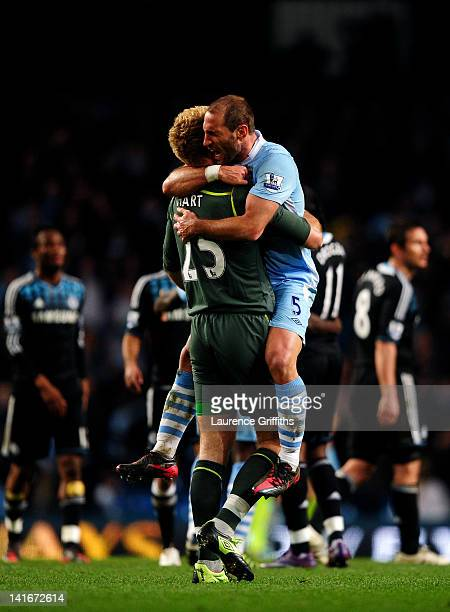 Goalkeeper Joe Hart and Pablo Zabaleta of Manchester City celebrate their team's victory as the final whistle blows during the Barclays Premier...