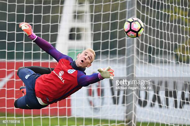 Goalkeeper Joe Hart dives for the ball during an England training session at St Georges Park on November 8, 2016 in Burton-upon-Trent, England....