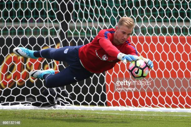 Goalkeeper Joe Hart makes a save during the England training session at the Chemin De Ronde Stadium on June 12 2017 in CroissysurSeine France