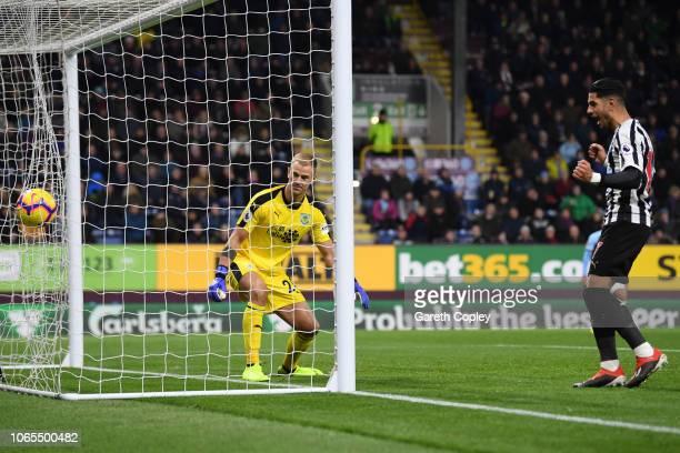 Goalkeeper Joe Hart of Burnley reacts as Ayoze Perez of Newcastle United celebrates as Ciaran Clark of Newcastle United scores his team's second goal...