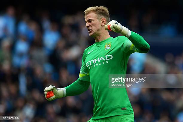 Goalkeeper Joe Hart of Manchester City celebrates after his team go 41 ahead during the Barclays Premier League match between Manchester City and...