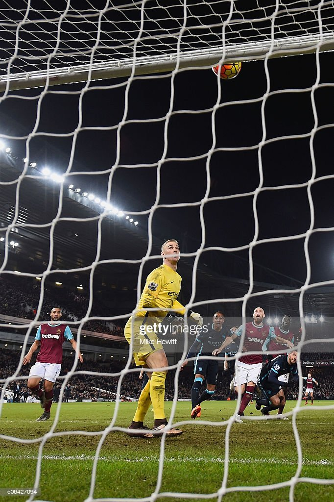 Goalkeeper Joe Hart of Manchester City looks on as the ball hits the crossbar after a header by Cheikhou Kouyate of West Ham United during the Barclays Premier League match between West Ham United and Manchester City at the Boleyn Ground on January 23, 2016 in London, England.