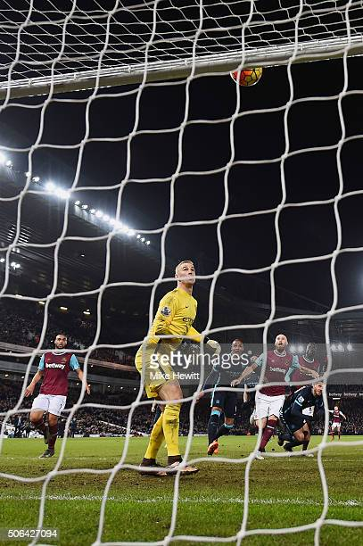 Goalkeeper Joe Hart of Manchester City looks on as the ball hits the crossbar after a header by Cheikhou Kouyate of West Ham United during the...