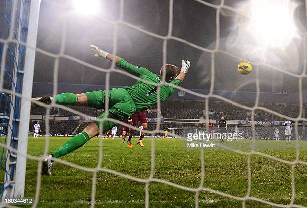Goalkeeper Joe Hart of Manchester City makes a save during the Barclays Premier League match between Queens Park Rangers and Manchester City at...