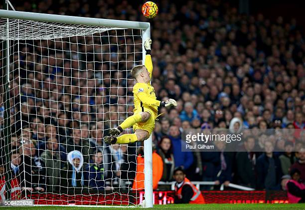 Goalkeeper Joe Hart of Manchester City saves a free kick from Dimitri Payet of West Ham United during the Barclays Premier League match between West...