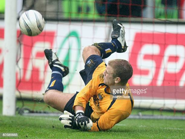 Goalkeeper Joe Hart of Manchester saves a penalty during UEFA Cup second qualifying round second leg match between Midtjylland and Manchester City at...